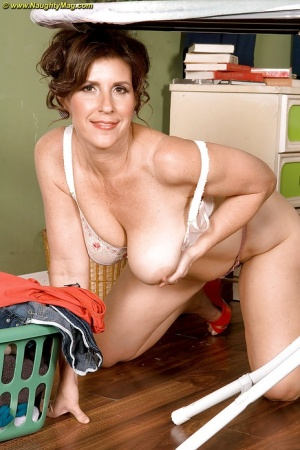 Brunette MILF Lorena Ponce gets wild and horny while doing the laundry.