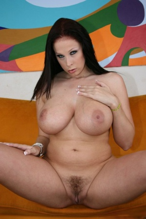 Busty pornstar babe Gianna Michaels shows her hot butt and hairy pussy