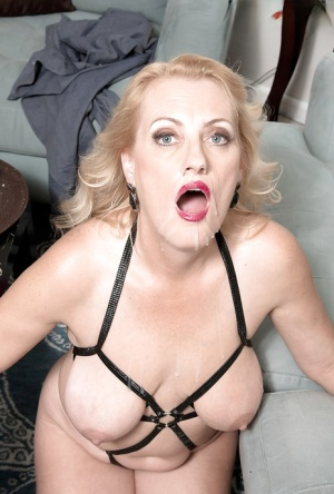 Older blonde MILF Lady Dulbin exposing saggy tits from underneath lingerie