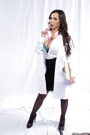Euro solo girl Nikki Benz strutting for tease pics in nylons and lingerie