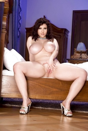 Brunette babe Karina Hart unleashing nice melons and toying shaved pussy