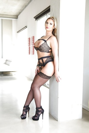 Blonde babe Phoenix Marie strutting in stockings and high heels