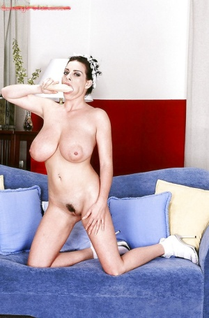 Euro babe Linsey Dawn McKenzie exposing large MILF tits and ass