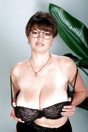 Glasses attired Greek MILF Diane Poppos baring nice melons and hairy twat