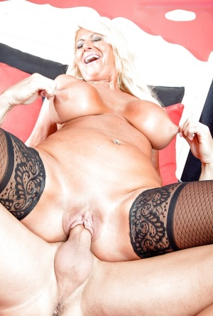 Over 50 blonde lady Annellise Croft exposing big knockers and shaved pussy 64486963