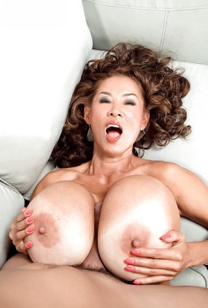 Chesty Asian cougar Minka taking hardcore cumshot from younger man