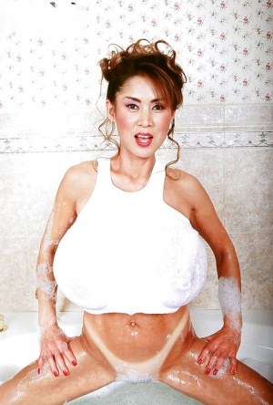 Asian solo model Minka reveals big tits before toying hairy pussy in shower