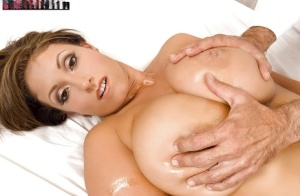 Busty MILF Eva Notty having big tits and nipples oiled on massage table