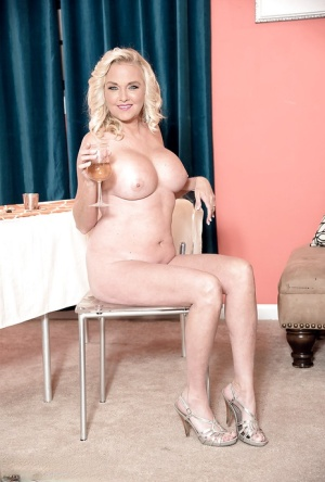 Over 40 blonde MILF babe model Sara Skiphers revealing big boobs and ass