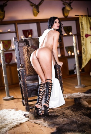Brunette babe Anissa Kate flaunting huge knockers in knee high boots