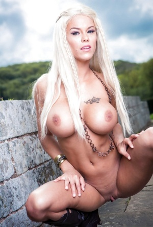 Blonde babe Peta Jensen flaunting big juggs and shaved pussy outdoors