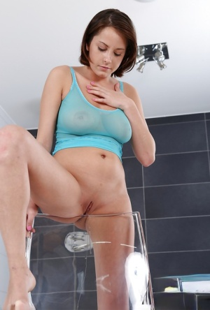 Busty European solo girl squirting golden pee from shaved pussy