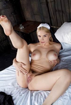 Blonde babe Sara Sloane strips off nuns uniform to expose big tits