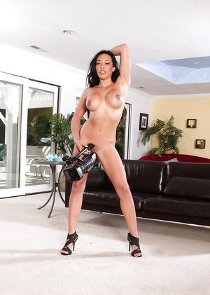 Asian solo girl Rio Lee showing off sexy pornstar legs in high heels