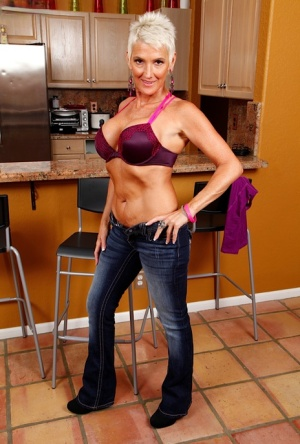 Short haired mature dame Lexy Cougar unleashing nice melons in kitchen
