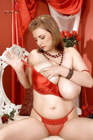 Solo girl Christy Marks frees huge knockers and shaved pussy form lingerie