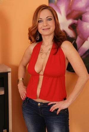Mature redhead Jessica Red revealing big all natural tits and trimmed twat