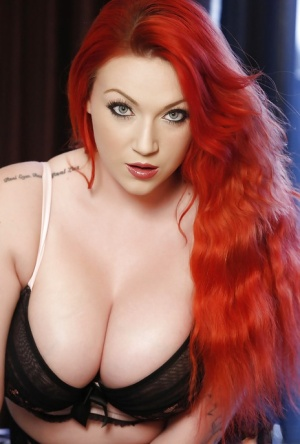 Curvy redheaded Euro babe Harmony Reigns baring large tits and tattoos