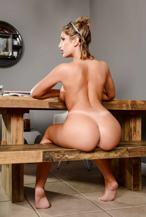 Coed babe August Ames showing off great legs before exposing nice ass