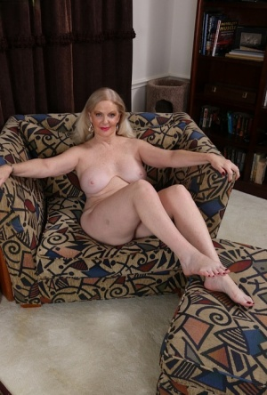 Clothed lady Judy Belkins pulling off nice pantyhose to reveal clitoris