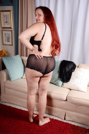 Older redhead BBW Laila sliding panties over big butt and shaved vagina