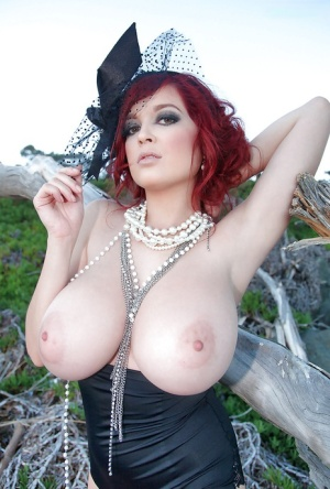 Leggy redhead pornstar Tessa Fowler touting huge natural tits outdoors