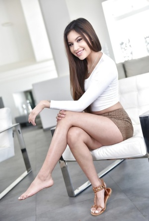 Clothed Asian babe Zaya Cassidy spreading sexy legs after undressing