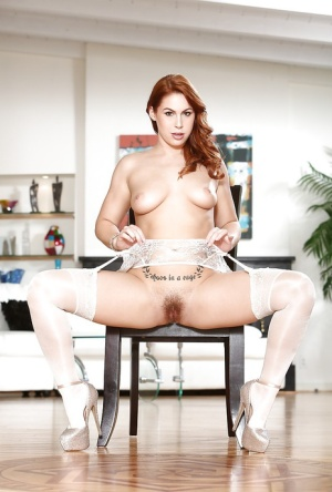 Stocking attired redhead Edyn Blair opening hairy pussy in white stockings