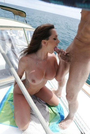 Tattooed chick Destiny Dixon flaunting large boobs while fucking on boat