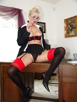 European MILF pornstar Kathy Anderson strutting in stockings and glasses 74854928