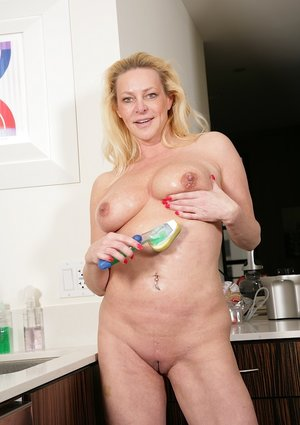 Older woman Shasha wetting large boobs in kitchen after undressing