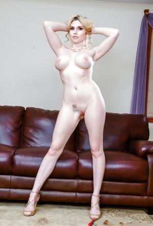 Blonde model Christie Stevens letting big natural tits fall free from dress