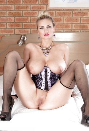 Beautiful solo girl Marie Lambo loosing nice melons from bustier in nylons