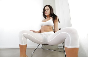 Hot Latina pornstar Keisha Grey baring big boobs before peeling off yoga pants