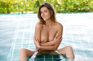 European centerfold model Kailena vaunting firm tits in swimming pool