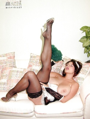 European maid Chloe Vevrier unveiling hooters in black nylons and heels