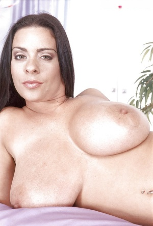 Brunette MILF Linsey Dawn licks her huge tits and rides a dildo to get orgasm