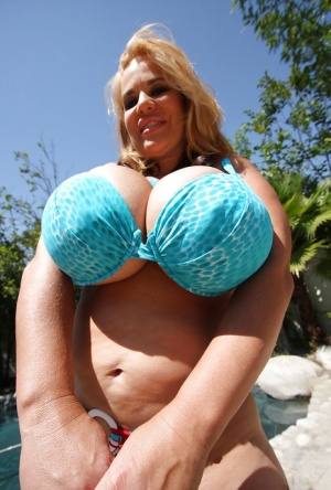 Mature babe Crystal Storm demonstrates her massive titties outdoor