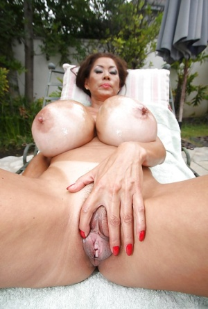 Mature Asian babe Minka spreading pussy and playing with her boobs