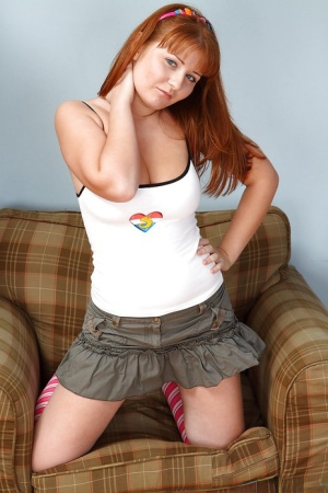 Red-haired teen Jess B takes off the skirt and fondles her hairy cunt 29372756