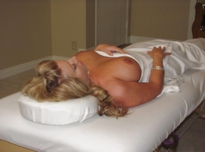 Blond mom Heather Summers shows off nice tits after disrobing on massage table