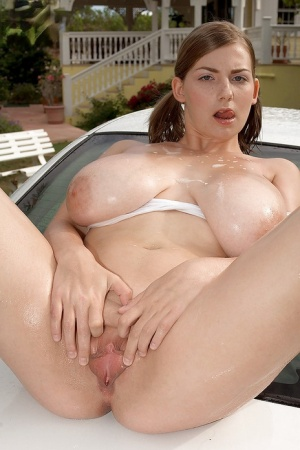 Chunky chick Christy Marks wetting hooters and pink pussy with garden hose