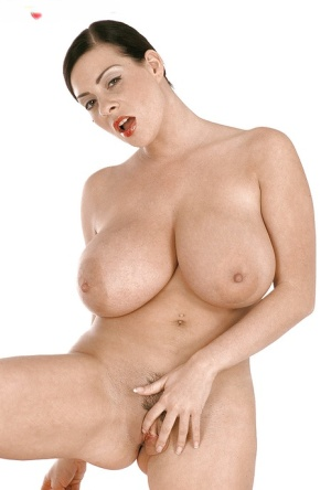 Brunette solo model Linsey Dawn McKenzie unveiling massive boobs