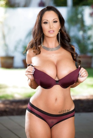 European MILF Ava Addams showing off hooters on steps outside