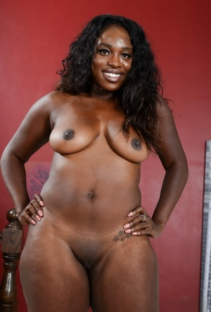 Ebony fatty Black Dahlia is proud of her chocolate brown body and bald twat
