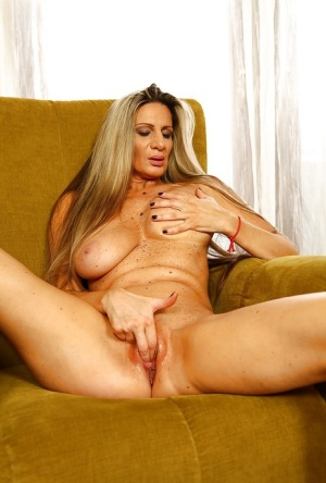 Older Euro dame Mercedes Silver releasing large boobs from see thru dress 73872617