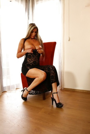 Older Euro woman Mercedes Silver fingering bald pussy after disrobing in chair