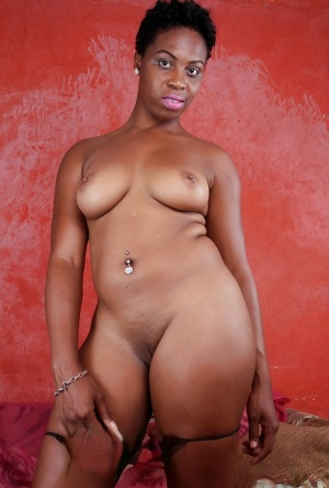 Short haired black chick Lulu making her nude modeling debut