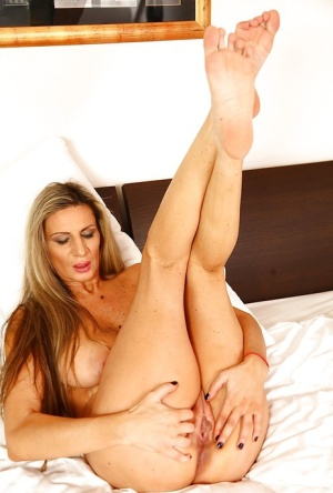 Older solo model Mercedes Silver playing with wet pussy after baring big tits 78806788