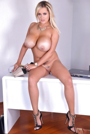 Blonde bombshell Katie Thornton sliding vibrator into shaved pussy in heels